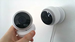 two security cameras one handheld