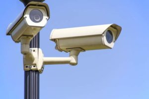 two security cameras on a pole